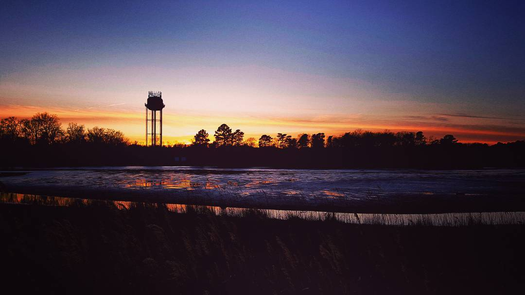 Sunset over  North Beach last night. #maryland #somd #sunset #sun #clouds #red #blue #water #watertower